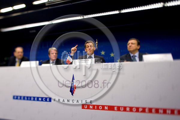 BRUSSELS - BELGIUM - 29 AUGUST 2008 -- Extraordinary EU Summit on Georgia -- The French President Nicolas SARKOZY during the final press conference.  On the podium with from left also Javier SOLANA, High Representative, Bernard KOUCHNER, Frenche Minister for Foreign Affairs, and Jose Manuel BARROSO, President of the European Commission-- Photo Erik LUNTANG / EUP-Images