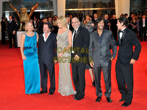 "JENNIFER LAWRENCE, JOAQUIM DE ALMEIDA, CHARLIZE THERON, GUILLERMO ARRIAGA, JOSE MARIA YASPIK & J.D. PARDO.Red Carpet arrivals for ""The Burning Plain"" premiere held at the Sala Grande during the 65th Venice Film Festival, .Venice, Italy, 29th August 2008. .full length blue satin dress long maxi silk silver grey gray beaded suit suits cast director.CAP/PL.© Phil Loftus/Capital Pictures"