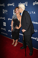 BEVERLY HILLS, CA - APRIL 12: Justina Machado, Norman Lear, At the 29th Annual GLAAD Media Awards at The Beverly Hilton Hotel on April 12, 2018 in Beverly Hills, California. <br /> CAP/MPI/FS<br /> &copy;FS/MPI/Capital Pictures