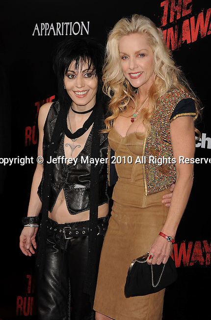 HOLLYWOOD, CA. - March 11: Musicians Joan Jett and Cherie Currie arrive at the Los Angeles Premiere of The Runaways at ArcLight Cinemas Cinerama Dome on March 11, 2010 in Hollywood, California.