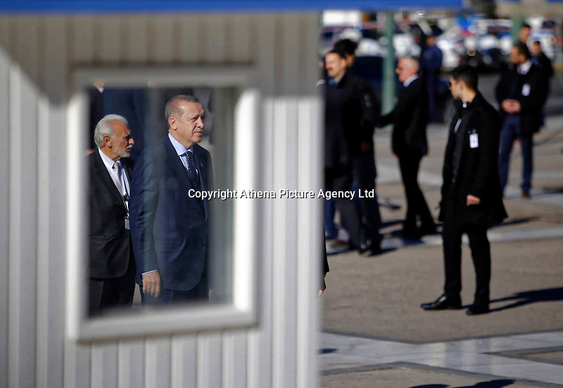 Pictured: Turkey president Recep Tayyip Erdogan (L), observes a minute's silence at the Unknown Soldier Monument outside the Greek Parliament in Syntagma Square.<br /> Re: Turkey's president Recep Tayyip Erdogan has begun a landmark visit to Greece. Thursday 07 December 2017