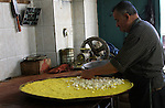 A Palestinian vendor prepares a traditional sweets Knafa in the West Bank city of Nablus on May 23,2010. Photo by Wagdi Eshtayah