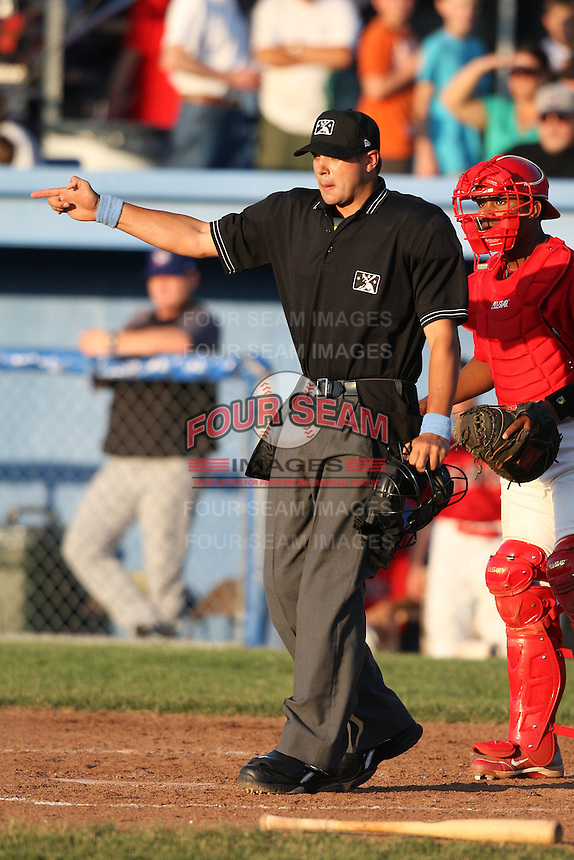 Home plate umpire Dustin Klinghagen during a game at Dwyer Stadium in Batavia, New York on June 19, 2010.  Photo By Mike Janes/Four Seam Images