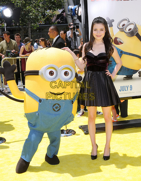 "MIRANDA COSGROVE .at the Universal Pictures' World Premiere of ""Despicable Me"" held during the Los Angeles Film Festival at Nokia Live in Los Angeles, California, USA, .June 27th 2010..full length dress sleeveless black pleated patent shoes hand on hip                                .CAP/RKE/DVS.©DVS/RockinExposures/Capital Pictures."