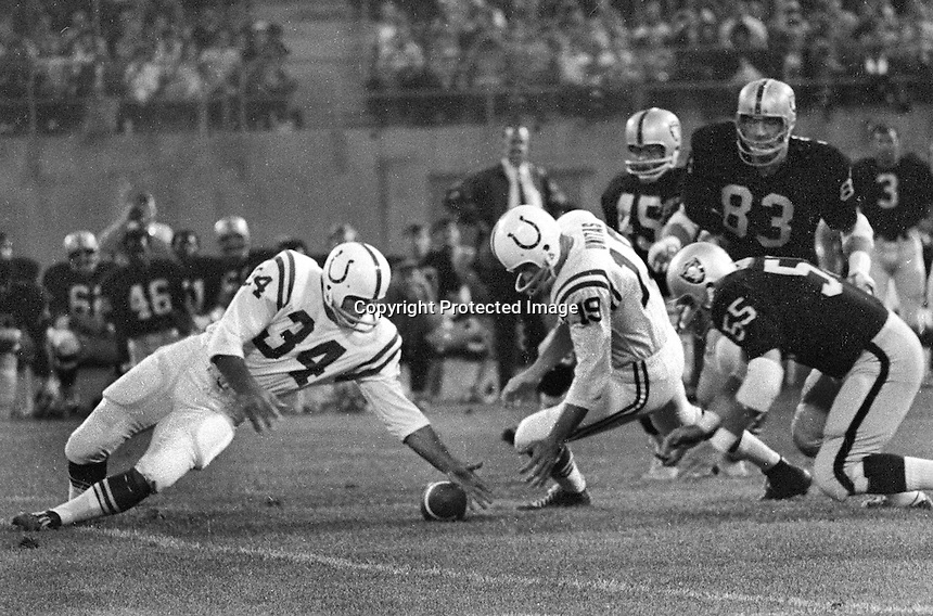 Baltimore Colts Tom Nowatske recovers fumble by QB Johnny Unitas ..Raiders Dan  Conners and Ben Davidson...(1970 photo/Ron Riesterer)