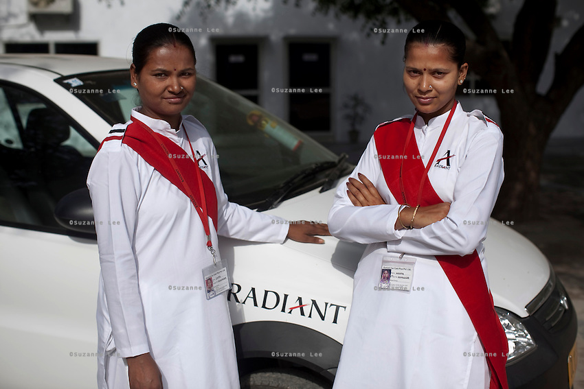 Ekta Yadav aged 28 (left) and Mamta aged 26 pose for a photo on 30th March 2010 in Radiant Limousine compounds.<br /> These female drivers were part of a program by Azad Foundation.<br /> Currently training their 4th batch of students, Azad Foundation was set up by Meenu Vadera (Executive Director) in New Delhi, India, to train Indian women in driving services. Upon completion, these women work as personal drivers for a period of time before they upgrade their driving licences to commercial licences, allowing them to drive taxis. With this program, Azad aims to empower Indian women including those previously abused or trafficked, while making Delhi a safer place for women travelling in public transport. Photo by Suzanne Lee for Panos London