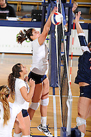 13 November 2010:  FIU's Sabrina Gonzalez (12) attempts to block a shot in the first set as the FIU Golden Panthers defeated the South Alabama Jaguars, 3-0 (25-12, 25-12, 25-20), at U.S Century Bank Arena in Miami, Florida.