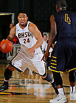 SPEARFISH, SD - DECEMBER 21, 2013:  Yoshio Allen #4 of Black Hills State looks to drive past Jon Conley #4 of Regis during their Rocky Mountain Athletic Conference game Saturday at the Donald E. Young Center in Spearfish, S.D.  (Photo by Dick Carlson/Inertia)