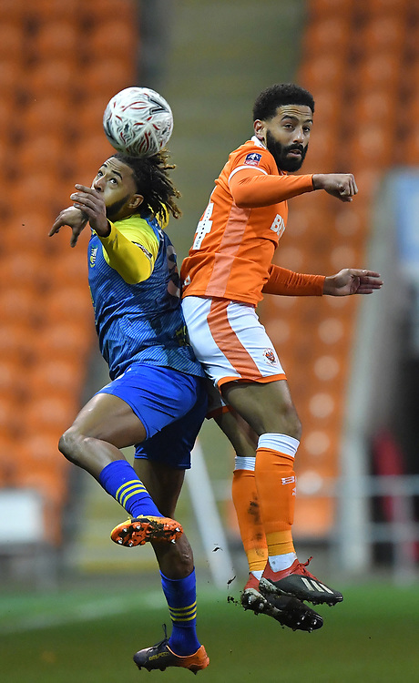 Blackpool's Liam Feeney battles with Solihull Moors' Jamie Reckord<br /> <br /> Photographer Dave Howarth/CameraSport<br /> <br /> The Emirates FA Cup Second Round Replay - Blackpool v Solihull Moors - Tuesday 18th December 2018 - Bloomfield Road - Blackpool<br />  <br /> World Copyright © 2018 CameraSport. All rights reserved. 43 Linden Ave. Countesthorpe. Leicester. England. LE8 5PG - Tel: +44 (0) 116 277 4147 - admin@camerasport.com - www.camerasport.com