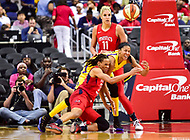 Washington, DC - June 15, 2018: Washington Mystics forward Monique Currie (25) fights for a loose ball against Los Angeles Sparks forward Candace Parker (3) during game between the Washington Mystics and Los Angeles Sparks at the Capital One Arena in Washington, DC. (Photo by Phil Peters/Media Images International)