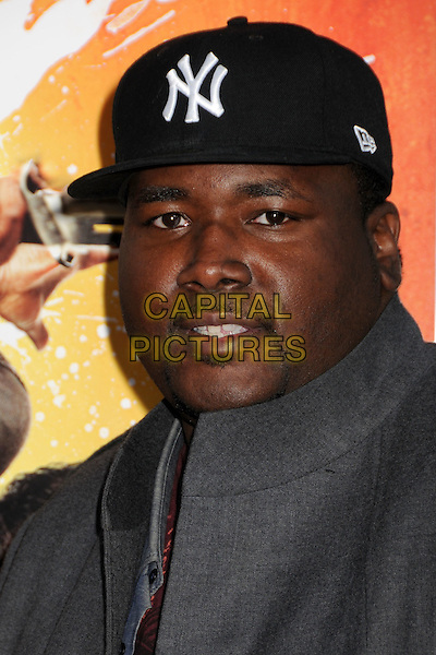 "QUINTON AARON .""The Losers"" Los Angeles Premiere held at Grauman's Chinese Theatre, Hollywood, California, USA, .20th April 2010..portrait headshot NY cap hat grey gray.CAP/ADM/BP.©Byron Purvis/AdMedia/Capital Pictures."