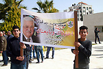Palestinian supporters of President Mahmoud Abbas hold his photos during a protest in solidarity with Abbas in the in the West Bank city of Ramallah, 25 February 2019. Photo by Ahmad Arouri