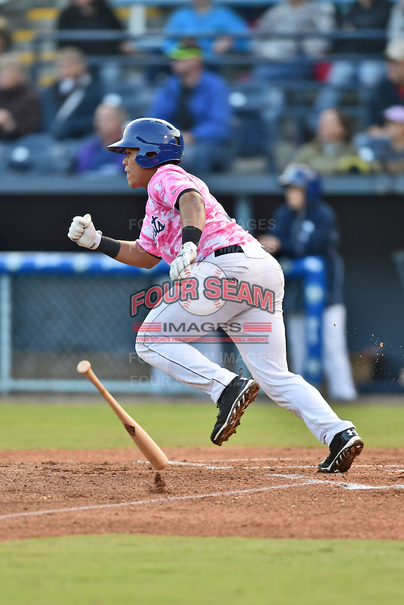 Asheville Tourists designated hitter Wilfredo Rodriguez #3 runs to first during a game against the  Lexington Legends at McCormick Field on May 16, 2014 in Asheville, North Carolina. The Tourists defeated the Legends 11-1. (Tony Farlow/Four Seam Images)