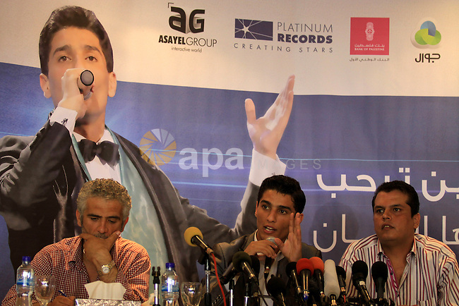 Mohamed Assaf (C), a Palestinian singer and winner in the Arab singing contest known as Arab Idol, speaks during a press conference at ArcMed hotel in Gaza city on June 26, 2013. Photo by Emad Nassar