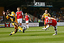 Adrian Cieslewicz of Wrexham's shot is blocked by Brian Saah of Cambridge United during the Blue Square Premier match between Cambridge United and Wrexham at the Abbey Stadium, Cambridge on 19th September, 2009..© Kevin Coleman 2009 .