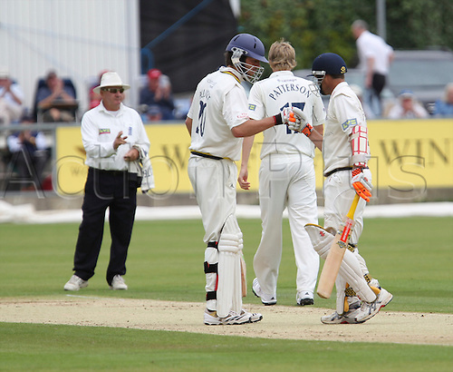 18.08.2010 Durhams Liam Plunkett congratulates Dale Benkinstein scoring 50 against Yorkshire on day 3 of the 2010 County Championship Cricket Durham v Yorkshire at Chester-Le-Street.