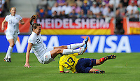 Lauren Cheney (l) of team USA and Yulieht Dominguez of team Colombia during the FIFA Women's World Cup at the FIFA Stadium in Sinsheim, Germany on July 2nd, 2011.