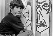 Sitting on a windowsill outside the art room, Summerhill school, Leiston, Suffolk, UK. 1968.
