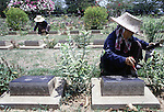 Thai workers use a brush to clean headstones in a cemetery filled with the graves of nearly 7,000 Australians and Englishmen who died  during World War II in Kanchanaburi, Thailand. Over 16,000 allied P.O.W.s died of starvation, maltreatment and disease while building the bridge on the River Kwai and a 250- mile railway from Thailand into Burma. The Bridge on the River Kwai, known to many P.O.W.'s as the bridge of sorrow, attracts thousands of tourists yearly. (Jim Bryant Photo)......