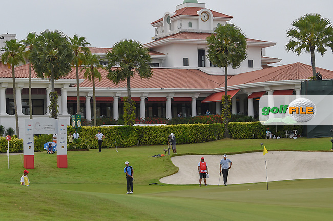 Sadom KAEWKANJANA (THA) chips on to 18 in front of the clubhouse during Rd 3 of the Asia-Pacific Amateur Championship, Sentosa Golf Club, Singapore. 10/6/2018.<br /> Picture: Golffile | Ken Murray<br /> <br /> <br /> All photo usage must carry mandatory copyright credit (© Golffile | Ken Murray)