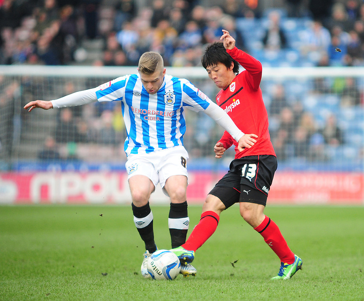 Cardiff City's Kim Bo-Kyung vies for possession with Huddersfield Town's Adam Clayton ..Football - npower Football League Championship - Huddersfield Town v Cardiff City  - Saturday 9th February 2013 - John Smith's Stadium - Huddersfield..