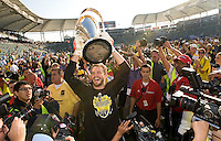 Goalkeeper William Hesmer holds up the MLS Cup Trophy after winning the MLS Cup 2008, Columbus Crew 3-1 over the New York Red Bulls, Sunday, November 23, 2008.