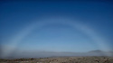 As the morning sun evaporates the frost from the ground atmospheric phenomenons like this fog bow are often witnessed.