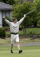 June 23, 2008:  Former Seattle SuperSonics and founder of the tournament, Detlef Schrempf raises his arms in the air after getting his put 28 inches from the cup on hole #4 while playing in the Detlef Schrempf celebrity golf classic held at McCormick Woods golf club in Port Orchard, WA.