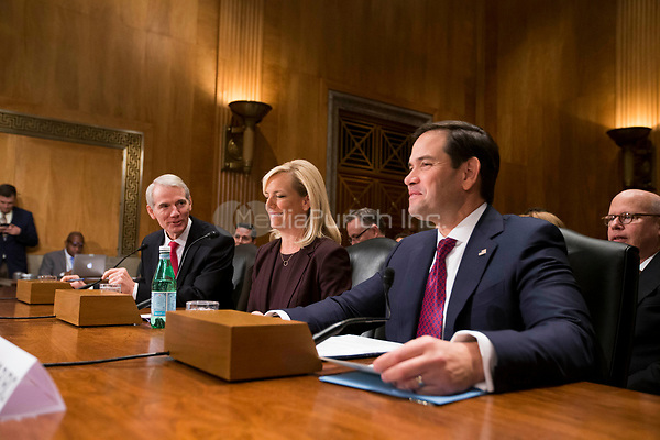 United States Senator Rob Portman (Republican of Ohio), left, Kirstjen Nielsen, center, and US Senator Marco Rubio, (Republican of Florida) right, prior Nielsen's confirmation hearing to be US Secretary of Homeland Security before the US Senate Homeland Security and Government Affairs Committee on Capitol Hill in Washington, D.C. on November 8th, 2017. <br /> Credit: Alex Edelman / CNP /MediaPunch