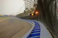 Oct. 11, 2009; Fontana, CA, USA; Detailed view of the soft wall and yellow caution lights on the catch fence prior to the Pepsi 500 at Auto Club Speedway. Mandatory Credit: Mark J. Rebilas-