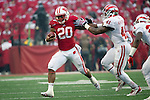 Wisconsin Badgers running back James White (20) stiff arms Indiana Hoosiers linebacker Clyde Newton (41)  during an NCAA Big Ten Conference Football game Saturday, November 16, 2013, in Madison, Wis. The Badgers won 51-3. (Photo by David Stluka)