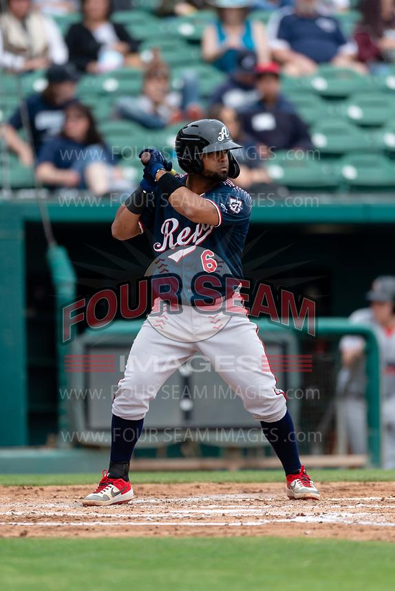 Reno Aces catcher Alberto Rosario (6) batting during a game against the Fresno Grizzlies at Chukchansi Park on April 8, 2019 in Fresno, California. Fresno defeated Reno 7-6. (Zachary Lucy/Four Seam Images)
