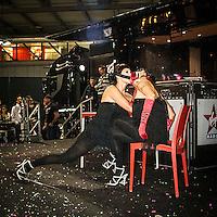 Motosalone Eicma edizione 2012: spettacolo di burlesque sul palco di Virgin Radio..International Motorcycle Exhibition 2012: burlesque spectacle on Virgin Radio stage.