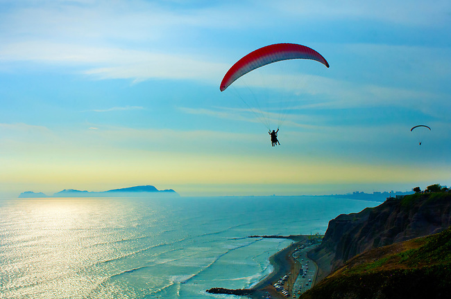Paragliders fly along the Pacific cliffs overloking the Costa Verde in the district of Miraflores in Lima, Peru.