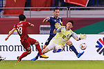 Gonda Shuichi of Japan (R) reaches for the ball after an attempt at goal by Nguyen Quang Hai of Vietnam (L) during the AFC Asian Cup UAE 2019 Quarter Finals match between Vietnam (VIE) and Japan (JPN) at Al Maktoum Stadium on 24 January 2018 in Dubai, United Arab Emirates. Photo by Marcio Rodrigo Machado / Power Sport Images
