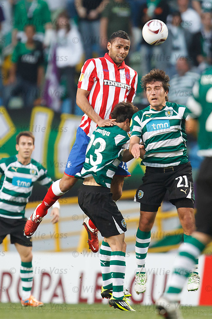 Kyle Bartley towers over Helder Postiga and Alberto Zapater