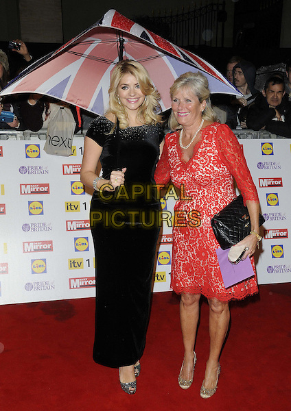 Holly Willoughby & her mother Lynn.The Pride of Britain Awards 2012, Grosvenor House Hotel, Park Lane, London, England..October 29th, 2012.full length black dress maxi union jack umbrella velvet silver shoes red lace mom mum daughter family.CAP/CAN.©Can Nguyen/Capital Pictures.