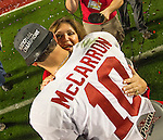 Alabama quarterback AJ McCarron hugs Terry Saban, wife of coach Nick Saban after the Crimson Tide defeated Notre Dame 42-14 to win the BCS National Championship football game at Sun Life Stadium in Miami on January 7, 2013. <br />