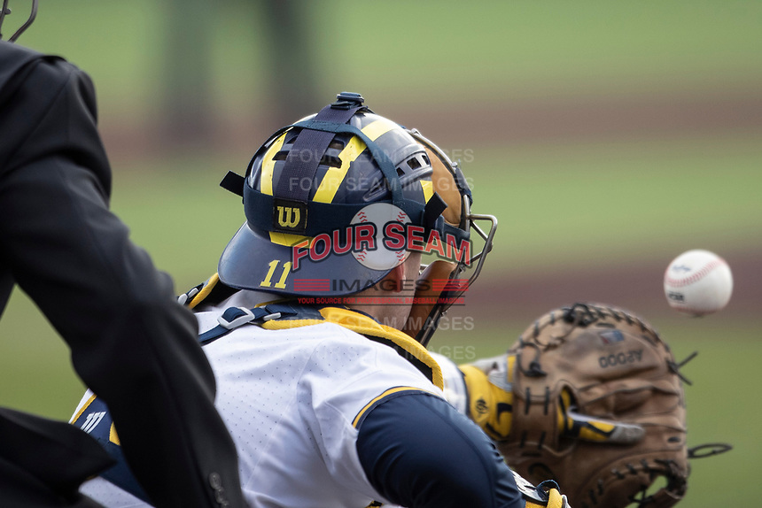 Michigan Wolverines catcher Harrison Slater (11) receives a pitch against the Western Michigan Broncos on March 18, 2019 in the NCAA baseball game at Ray Fisher Stadium in Ann Arbor, Michigan. Michigan defeated Western Michigan 12-5. (Andrew Woolley/Four Seam Images)