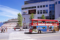 "Sightseeing Tour Bus and Cruise Ship at ""Canada Place"" Trade and Convention Centre and Cruise Ship Terminal, Vancouver, British Columbia, Canada"