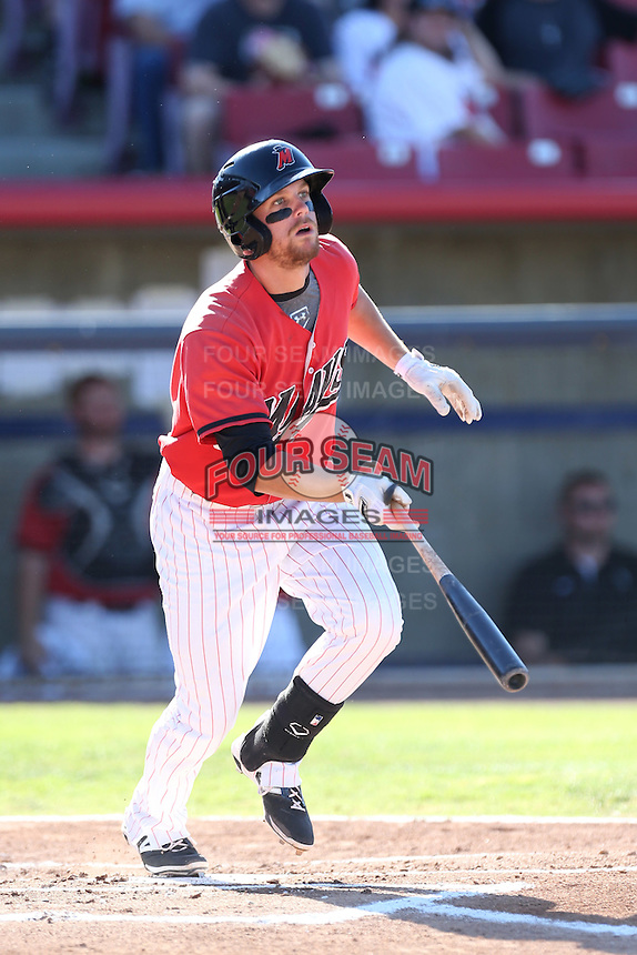 Tyler Smith #12 of the High Desert Mavericks bats against the Modesto Nuts at Heritage Field on June 29, 2014 in Adelanto, California. High Desert defeated Modesto, 6-1. (Larry Goren/Four Seam Images)