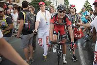 Greg Van Avermaet (BEL/BMC) being escorted to the podium after winning the stage<br /> <br /> stage 13: Muret - Rodez<br /> 2015 Tour de France