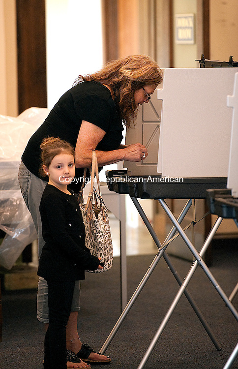 NAUGATUCK, CT--- -092315JS07---Delilah Dinis, 4, of Naugatuck, looks around while her grand-mother Lorraine Ardry Voters check in with volunteers on Tuesday as they cast their votes for Naugatuck's second referendum on the proposed town and school budgets at the former train station in Naugatuck. <br /> Jim Shannon Republican-American