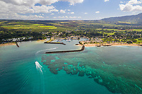 Aerial view of small boats enter Hale'iwa Harbor through the surrounding reef, North Shore of O'ahu.