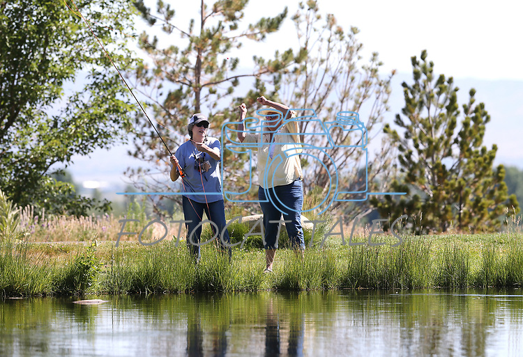 Breast cancer survivor Jeannie Drown, left, learns from guide Kellen Brehm during a Casting for Recovery retreat in Gardnerville, Nev., on Friday, June 30, 2017. <br /> Photo by Cathleen Allison/Nevada Photo Source