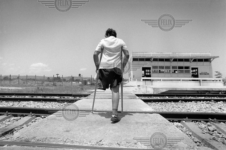 A man who lost his leg fighting in the Angola campaign. During the 1970s , Cuban troops were flown to Angola to support the Marxist government against opposition forces....