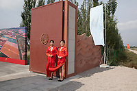 China - Ningxia - Chinese hostesses welcoming guests at the opening of the Copower Chateau. The grand opening of the Chateau Copower Jade, on the outskirts of Yinchuan. The 80-hectare-vineyard and the winery's modern structure cost 19 million euros and won the 2018 RVF Wine Design Award.