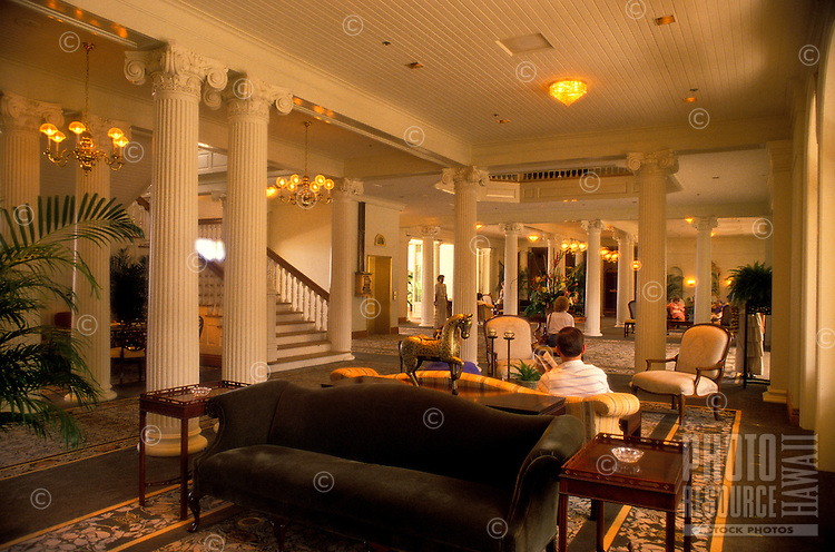 Tourists sit in the lobby of the Sheraton Moana Hotel, Hawaii's oldest hotel