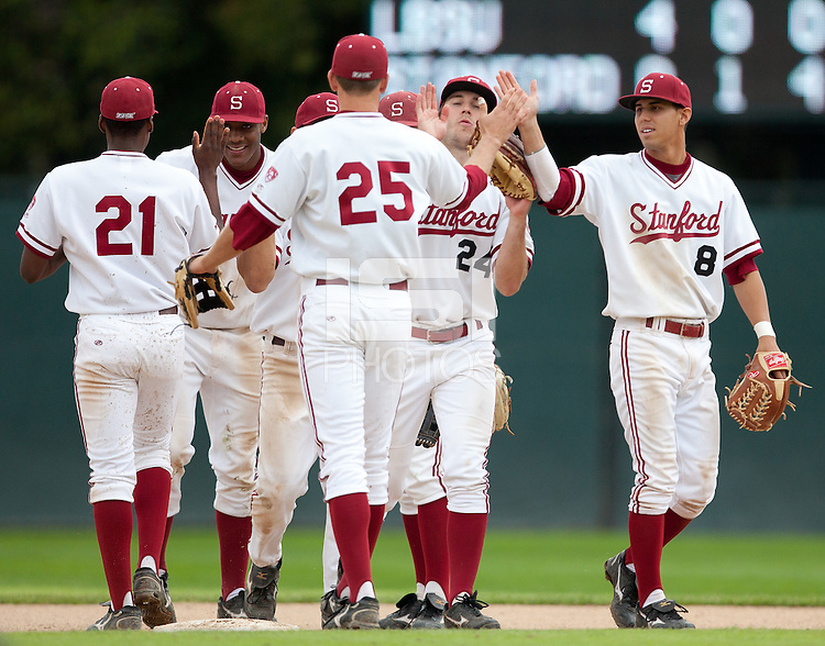 STANFORD, CA - March 27, 2011: The Stanford baseball team comes in from the field celebrating after Stanford's game against Long Beach State at Sunken Diamond. Stanford won 6-5.