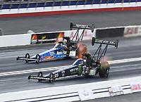Feb 9, 2020; Pomona, CA, USA; NHRA top fuel driver Brittany Force (near) alongside Clay Millican during the Winternationals at Auto Club Raceway at Pomona. Mandatory Credit: Mark J. Rebilas-USA TODAY Sports
